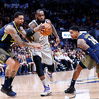 07 March 2018: Cleveland Cavaliers forward LeBron James (23) drives past Denver Nuggets forward Will Barton (5) and Denver Nuggets guard Gary Harris (14) during the Cleveland Cavaliers 113-108 victory over the Denver Nuggets, at the Pepsi Center, Denver, Colorado, USA.