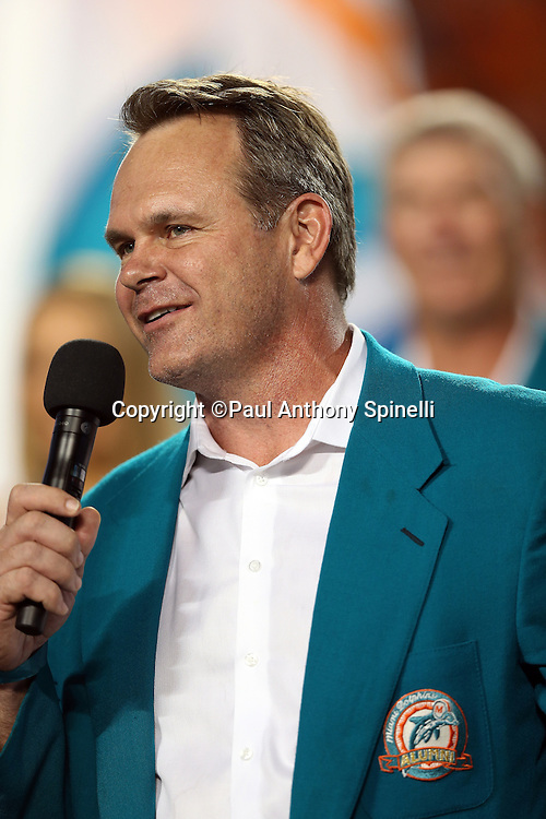 Former Miami Dolphins linebacker John Offerdahl addresses the fans on the night he is inducted into the Dolphins Ring of Honor at halftime during the NFL week 9 football game against the Cincinnati Bengals on Thursday, Oct. 31, 2013 in Miami Gardens, Fla.. The Dolphins won the game 22-20 in overtime. ©Paul Anthony Spinelli