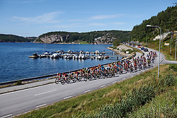 The peloton head along the lakeside during Ladies Tour of Norway 2019 - Stage 4, a 154 km road race from Svinesund to Halden, Norway on August 25, 2019. Photo by Sean Robinson/velofocus.com