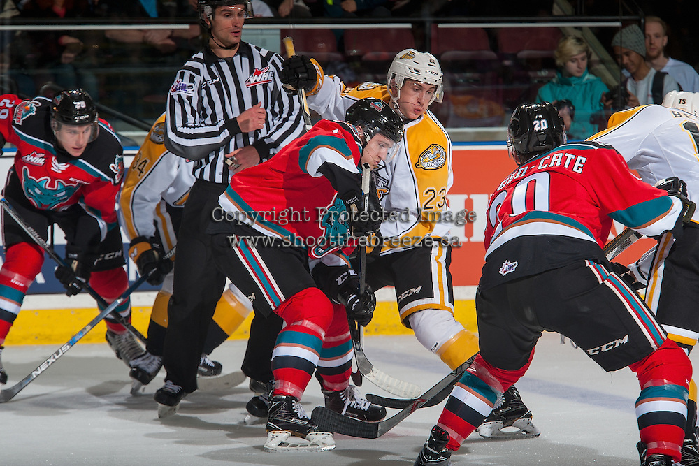 KELOWNA, CANADA - DECEMBER 3: Jake Kryski #14 of the Kelowna Rockets faces off against Cole Reinhardt #23 of the Brandon Wheat Kings on December 3, 2016 at Prospera Place in Kelowna, British Columbia, Canada.  (Photo by Marissa Baecker/Shoot the Breeze)  *** Local Caption ***