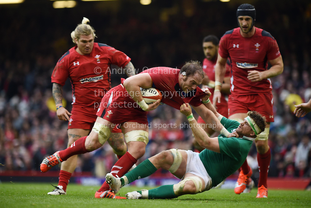 Alun Wyn Jones of Wales is tackled by Jamie Heaslip of Ireland. RBS Six nations 2015 championship, Wales v Ireland  at the Millennium stadium in Cardiff, South Wales on Saturday 14th March 2015<br /> pic by Andrew Orchard, Andrew Orchard sports photography.