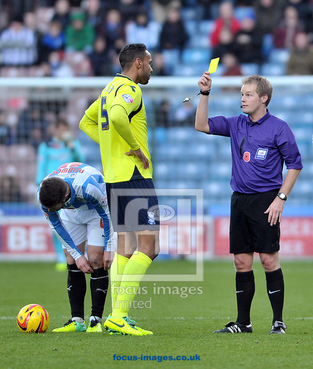 Picture by Graham Crowther/Focus Images Ltd +44 7763 140036<br /> 09/11/2013<br /> Kyle Bartley of Birmingham City is shown his first yellow card during the Sky Bet Championship match at the John Smiths Stadium, Huddersfield.
