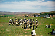 Captioned as 'Basuto Dancers' South Africa 1979 group of women wearing traditional costume practice their dancing in rural location