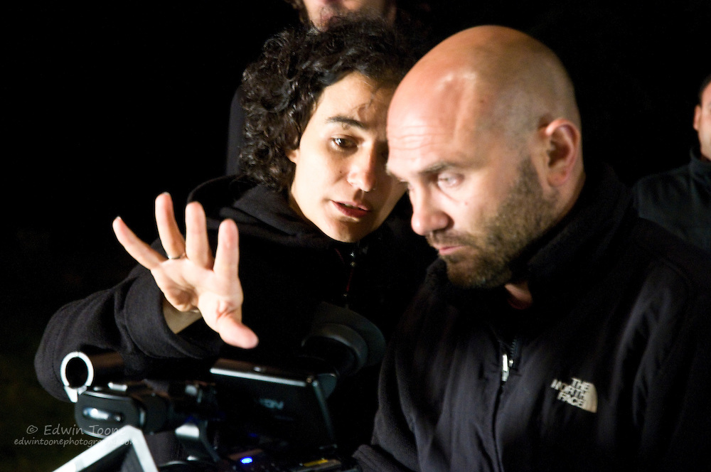 Eva and the camera man go over the shot and plan for the next scene.