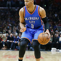 21 December 2015: Oklahoma City Thunder guard Russell Westbrook (0) dribbles during the Oklahoma City Thunder 100-99 victory over the Los Angeles Clippers, at the Staples Center, Los Angeles, California, USA.