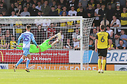 Coventry City midfielder Zain Westbrooke (25) shoots and his shot rebounds off the post during the EFL Sky Bet League 1 match between Burton Albion and Coventry City at the Pirelli Stadium, Burton upon Trent, England on 14 September 2019.