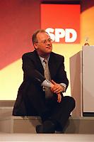 08 DEC 1999, BERLIN/GERMANY:<br /> Rudolf Scharping, Stellv. SPD Parteivorsitzender, setzt sich zu später Stunde auf einen Absatz auf dem Podium, SPD Bundesparteitag, Hotel Estrell<br /> Rudolf Scharping, Fed. Minister of Defense and SPD Vice Chairman, during the Federal Party Congress of the Social Democratic Party<br /> IMAGE: 19991208-01/11-31<br /> KEYWORDS: Parteitag