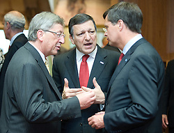 Jean-Claude Juncker, Luxembourg's prime minister, left, speaks with Jose Manuel, Barroso, president of the European Commission, center, and Jan Peter Balkenende, the Netherlands's prime minister, right, before the start of the European Summit, in Brussels, Thursday, June 18, 2009. (Photo © Jock Fistick)