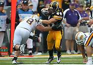 September 3, 2011: Iowa Hawkeyes linebacker James Morris (44) avoids Tennessee Tech Golden Eagles guard Scott Schweitzer (78) after an interception during the first half of the game between the Tennessee Tech Golden Eagles and the Iowa Hawkeyes at Kinnick Stadium in Iowa City, Iowa on Saturday, September 3, 2011. Iowa defeated Tennessee Tech 34-7 in a game stopped at one point due to lightning and rain.