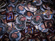 Badges with the image of President Hugo Chávez in a street stall in Los Proceres, Caracas, Venezuela, 12th March 2013. During Hugo Chávez funeral many people and stand sold miscellaneous articles that perpetuate Chávez presence. Everything from T-shirts, badges, earrings, baseball caps, sun glasses seemed suitable to have the President's image. The cult of Chávez is now more alive than ever.