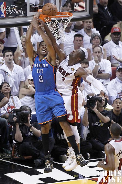 17 June 2012: Oklahoma City Thunder shooting guard Thabo Sefolosha (2) goes for the reverse layup past Miami Heat shooting guard Dwyane Wade (3) during the Miami Heat 91-85 victory over the Oklahoma City Thunder, in Game 3 of the 2012 NBA Finals, at the AmericanAirlinesArena, Miami, Florida, USA.