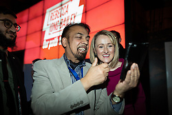 © Licensed to London News Pictures. 17/01/2020. Manchester, UK. REBECCA LONG-BAILEY (r) poses for a selfie with Cllr AHMED ALI (l) at the end of a speech and Q&A . Salford & Eccles MP Rebecca Long-Bailey launches her campaign to succeed Jeremy Corbyn in the race for Labour Party leadership , at an event in the Museum of Science and Industry in Manchester City Centre . Photo credit: Joel Goodman/LNP