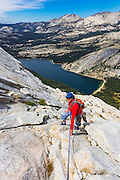 Rock climber on Tenaya Peak, Tuolumne Meadows, Yosemite National Park, California USA