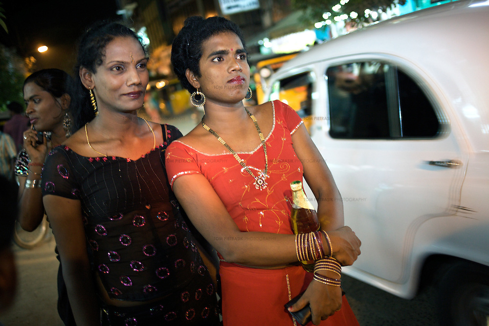 Aravanis out for an evening in the town of Vilappuram during the week-long transgender gathering.  ..India's transexual community has a recorded history of more than four thousand years. Many consider the The Third Sex, also known as Aravanis, to posses special powers allowing them to determine the fate of others. As such, they are not only revered but despised and feared too. Resigned to the fringes of society, segregated and excluded from most occupations, many Aravanis are forced to turn to begging and sex work in order to earn a living. ..The annual transgender festival in the village of Koovagam, near Vilappuram, offers an escape from this often desolate existence. For some, the week-long partying and frenetic sex trade that culminates in the Koovagam festival is about fulfilling lustful desires. For others, the gathering provides a chance for transgenders to bond, share experiences, join the wider homosexual gay-community and coordinate their campaign for recognition and tackle the challenge of HIV/AIDS. ..It is the Indian state of Tamil Nadu that the eighty-thousand-strong Aravani community has made advances in their fight for rights. In 2009, the Tamil Nadu state government began providing sex-change surgery free of cost. The state has also offers special third-gender ration cards, passports and reserved seats in colleges. And 2008 the launch of Ippudikku Rose, a Tamil talk-show fronted by India's first transgender TV-host and the release of a mainstream Tamil film staring an Aravani in the lead-role. ..These advances clearly signal a victory for south India's transgenders, but they have also exposed deep divisions within the community. There is a very real gulf that separates the majority poor from their potentially influential but often reticent, upper-class sisters. ..Photo: Tom Pietrasik.Vilappuram District, Tamil Nadu. India.May 2009