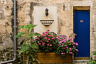The entrance to a home in Bayeux, France,  is through a colorful blue door.