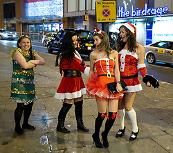 "© licensed to London News Pictures. Manchester, UK 17/12/2011. Despite freezing temperatures, ""Mad Friday"" revellers in Manchester enjoy what is traditionally the busiest night of the year for emergency services, before Christmas. Photo credit: Joel Goodman/LNP"