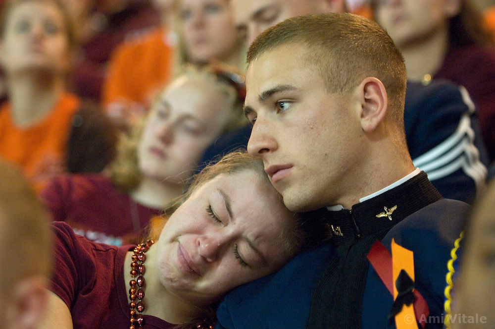 Blacksburg, Va. UNITED STATES: Virginia Tech Cadet Neal Ballas and Jill Weikert mourn during a convocation and memorial April 17, 2007 for victims of the shooting massacre at Virginia Tech University in Blacksburg, Virginia. A 23-year-old student from South Korea was identifiedas the gunman who carried out the deadliest school shooting in US history.  33 people died on Monday, police named the gunman as Cho Seung-Hui, a student at the school and resident alien in the United States. (AMi Vitale)