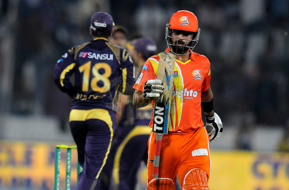 Ahmed Shehzad of Lahore Lions walks back after getting out during match 7 of the Oppo Champions League Twenty20 between the Kolkata Knight Riders and the Lahore Lions held at the Rajiv Gandhi Cricket Stadium, Hyderabad, India on the 21st September 2014<br /> <br /> Photo by:  Pal Pillai / Sportzpics/ CLT20<br /> <br /> <br /> Image use is subject to the terms and conditions as laid out by the BCCI/ CLT20.  The terms and conditions can be downloaded here:<br /> <br /> http://sportzpics.photoshelter.com/gallery/CLT20-Image-Terms-and-Conditions-2014/G0000IfNJn535VPU/C0000QhhKadWcjYs
