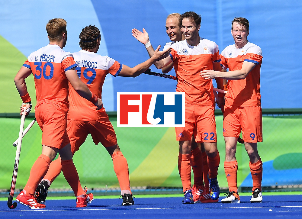 Netherland's Rogier Hofman (2R) celebrates scoring a goal with teammates during the men's field hockey Netherland's vs India match of the Rio 2016 Olympics Games at the Olympic Hockey Centre in Rio de Janeiro on August, 11 2016. / AFP / MANAN VATSYAYANA        (Photo credit should read MANAN VATSYAYANA/AFP/Getty Images)