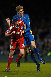 PORTSMOUTH, ENGLAND - Saturday, February 7, 2009: Liverpool's Jamie Carragher and Portsmouth's Peter Crouch during the Premiership match at Fratton Park. (Mandatory credit: David Rawcliffe/Propaganda)