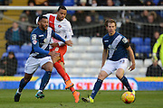 Birmingham City midfielder David Davis skips past Charlton Athletic midfielder Jordan Cousins during the Sky Bet Championship match between Birmingham City and Charlton Athletic at St Andrews, Birmingham, England on 21 November 2015. Photo by Alan Franklin.