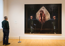 Man looking at painting Tragic Form (Skate) by Ken Currie on display at Scottish National Gallery of Modern Art in Edinburgh, Scotland, United Kingdom
