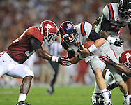 Ole Miss quarterback Bo Wallace (14) vs. Alabama linebacker C.J. Mosley (32) at Bryant-Denny Stadium in Tuscaloosa, Ala. on Saturday, September 29, 2012.