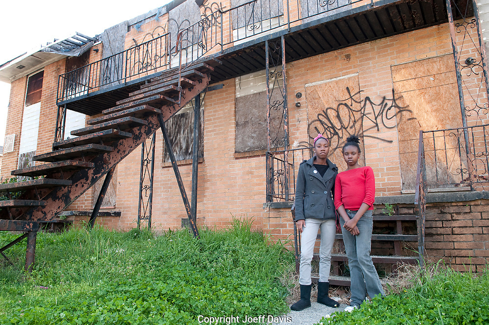 "Nina, 17 and Gigi, 11, pictured in front of the abandoned building next to their home in Vine City. ""It makes me sad and it makes the community look bad,"" said Nina who wants to be a registered nurse or a surgeon when she grows up. ""I wish they would get some of the dope dealers off the street and get the homeless somewhere to live."