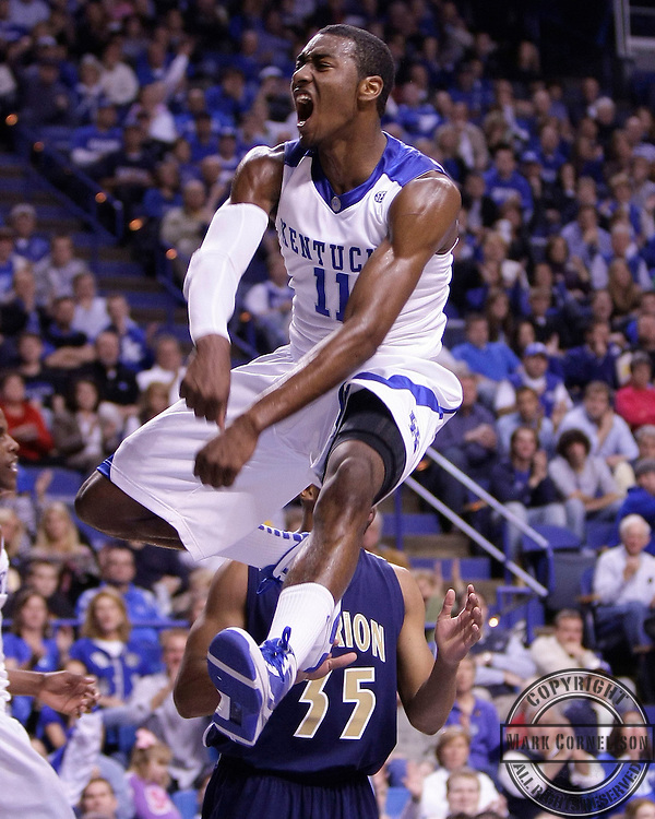John Wall was jubilant after a first half dunk as  Kentucky played Clarion  on Friday November 6, 2009 in  Lexington, Ky. Photo by Mark Cornelison | Staff