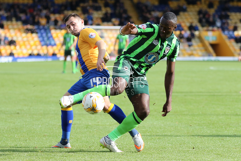 battle of the 14's Ade Azeez of AFC Wimbledon and Nathan Thomas during the Sky Bet League 2 match between Mansfield Town and AFC Wimbledon at the One Call Stadium, Mansfield, England on 5 September 2015. Photo by Stuart Butcher.