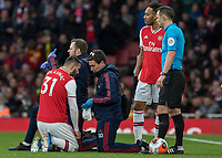 Football - 2019 / 2020 Premier League - Arsenal vs. Everton<br /> <br /> The Arsenal physio signals that Sead Kolasinac (Arsenal FC) is not fit to continue at The Emirates Stadium.<br /> <br /> COLORSPORT/DANIEL BEARHAM