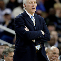 January 22, 2011; New Orleans, LA, USA; San Antonio Spurs head coach Gregg Popovich watches from the bench during the fourth quarter against the New Orleans Hornets at the New Orleans Arena. The Hornets defeated the Spurs 96-72.  Mandatory Credit: Derick E. Hingle