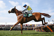 Knock House and Henry Brooke clear the last hurdle in the 1:45pm The Gaskells Handicap Hurdle (Grade 3) during the Grand National Meeting at Aintree, Liverpool, United Kingdom on 6 April 2019.
