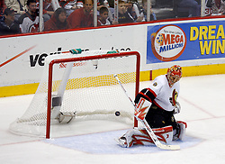 April 26, 2007; East Rutherford, NJ, USA; Ottawa Senators goalie Ray Emery (1) makes a save during the first period at Continental Airlines Arena in East Rutherford, NJ.