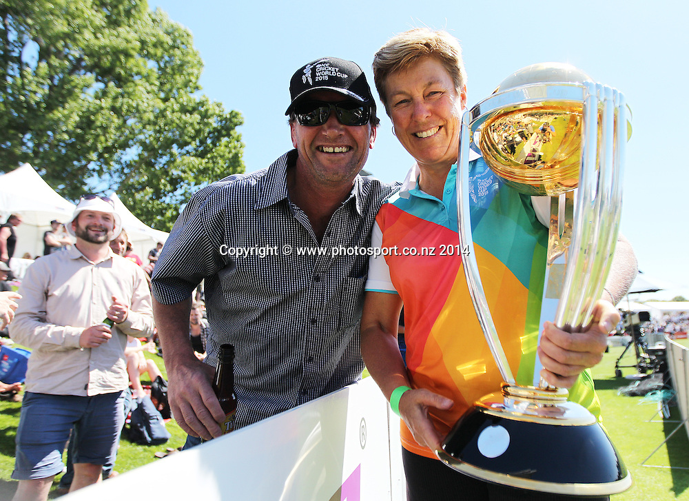 Debbie Hockley, a former New Zealand cricketer wearing a volunteers CWC uniform holding the Cricket World Cup with a fan on Day 1 of the boxing Day Cricket Test Match  the Black Caps v Sri Lanka at Hagley Oval, Christchurch. 26 December 2014 Photo: Joseph Johnson / www.photosport.co.nz