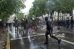 © Licensed to London News Pictures. 06/06/2020. London, UK. Mounted police in riot gear move in to remove protesters gathered in Westminster, central London to take part in a Black Lives Matter demonstration over the killing of African American George Floyd. The death of George Floyd, who died after being restrained by a police officer In Minneapolis, Minnesota, caused widespread rioting and looting across the USA. Photo credit: Ben Cawthra/LNP