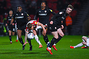 Liam Lindsay of Barnsley (6) fouls James Coppinger of Doncaster Rovers (26) during the EFL Sky Bet League 1 match between Doncaster Rovers and Barnsley at the Keepmoat Stadium, Doncaster, England on 15 March 2019.