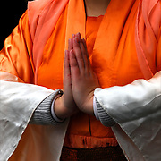 Close up Buddhist hands in prayer, ethnic pride and tradition in the Chinese Lunar New Year Celebration in New York Chinatown.