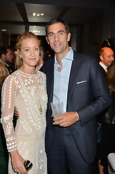 HUGH & ROSE VAN CUTSEM at a party to celebrate the publication of Flourish by Willow Crossley held at OKA, 155-167 Fulham Rd, London on 4th October 2016.