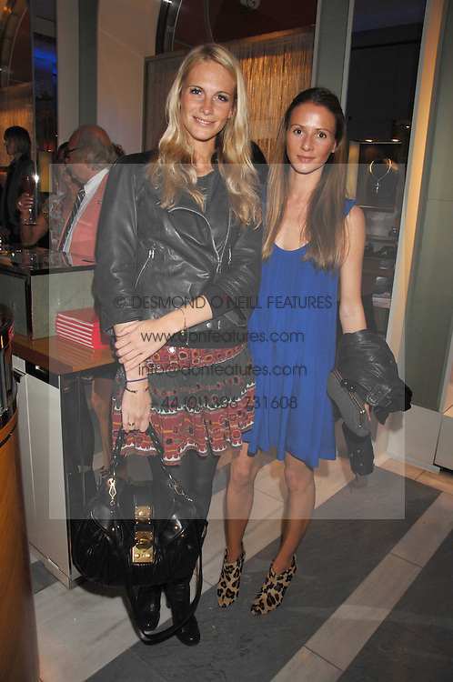 Left to right, POPPY DELEVIGNE and AMANDA CROSSLEY at a preview of Garrard's new collections and celebrates a Kaleidoscope of Colour at Garrard, 24 Albemarle Street, London on 10th May 2007.<br /><br />NON EXCLUSIVE - WORLD RIGHTS