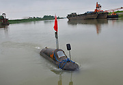 MAANSHAN, CHINA - APRIL 27: (CHINA OUT) <br /> <br /> Homemade Submarine <br /> <br /> Zhang Shengwu drives his homemade submarine in the river at Zhangdu village on April 27, 2016 in Maanshan, Anhui Province of China. 51-year-old Zhang Shengwu, who built a dock and sold building materials, used over 5,000 yuan (about 771 USD) make a submarine in two month in Maanshan. The 6-meter-long, 2 tons submarine was powered by a tricycle motor, and had no Oxygen supply system. The submarine could dove over one meter under water, and Zhang had obtained national patent for it on February in 2016. <br /> ©Exclusivepix Media
