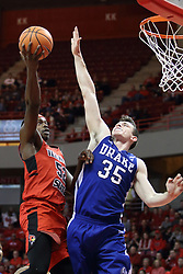 21 February 2018: Milik Yarbrough shoots over Nick McGlynn during a College mens basketball game between the Drake Bulldogs and Illinois State Redbirds in Redbird Arena, Normal IL