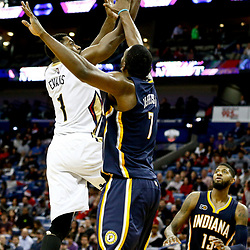 Dec 15, 2016; New Orleans, LA, USA; New Orleans Pelicans guard Tyreke Evans (1) shoots over Indiana Pacers center Al Jefferson (7) during the second half of a game at the Smoothie King Center. The Pelicans defeated the Pacers 102-95. Mandatory Credit: Derick E. Hingle-USA TODAY Sports
