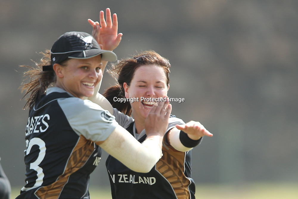 Suzie Bates and Erin Bermingham celebrate the wicket of Tremayne Smartt during the ICC Women's World Twenty20 - between The West Indies and New Zealand held at the Galle International Stadium in Galle, Sri Lanka on the 26th September 2012<br /> <br /> Photo by Ron Gaunt/SPORTZPICS/PHOTOSPORT