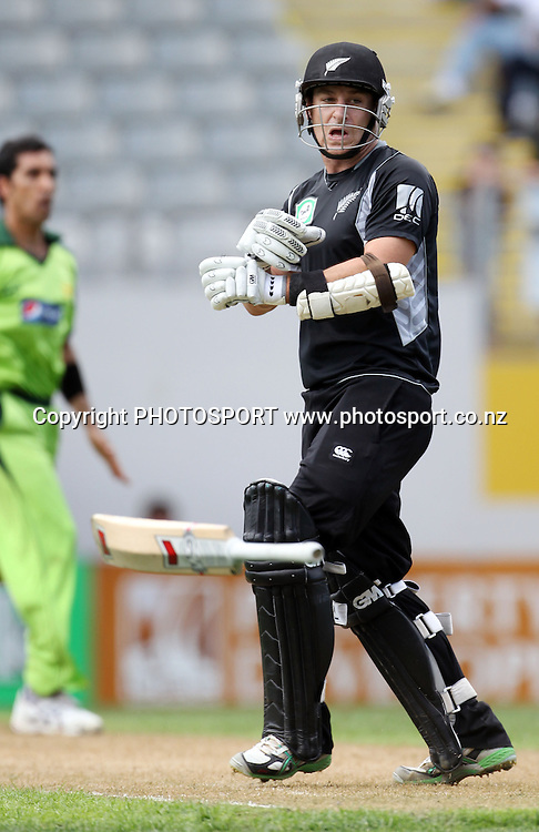 Nathan McCullum loses his grip on his bat during the 6th ODI, Black Caps v Pakistan, One Day International Cricket. Eden Park, Auckland, New Zealand. Saturday 5 February 2011. Photo: Andrew Cornaga/photosport.co.nz