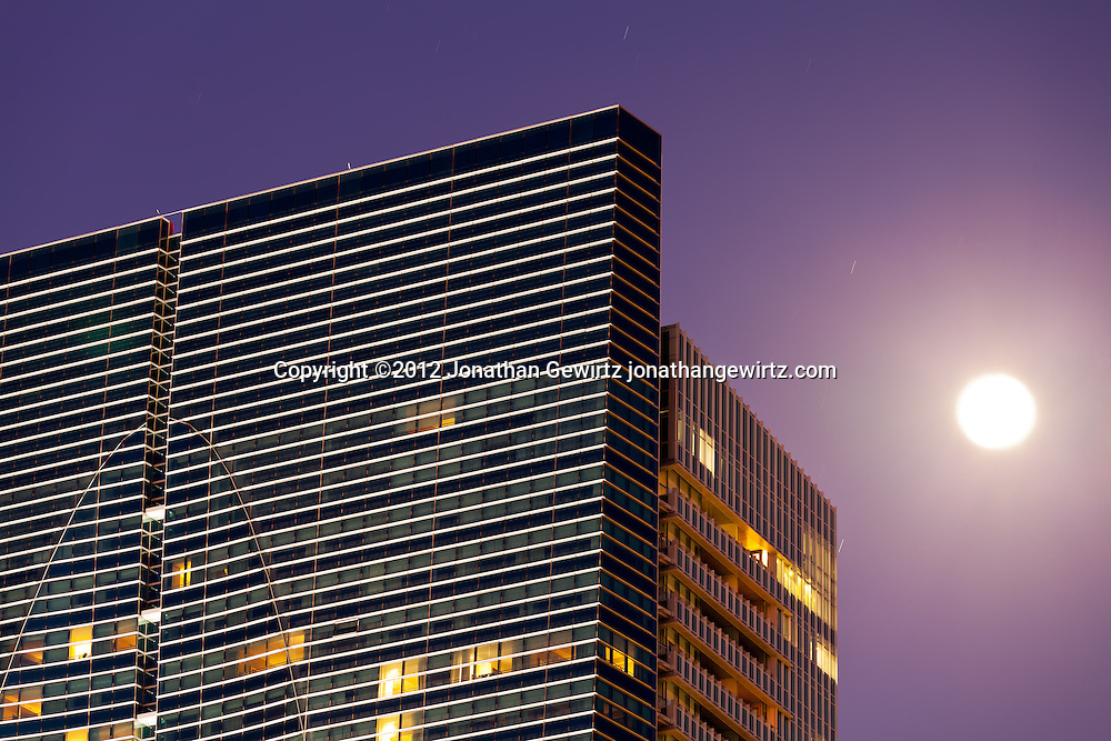 Upper right corner of a downtown Miami office building with the full moon in the background. WATERMARKS WILL NOT APPEAR ON PRINTS OR LICENSED IMAGES.