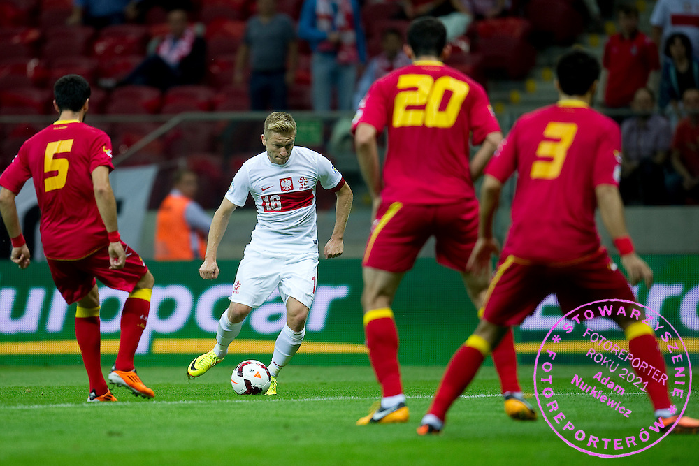 Poland's Jakub Blaszczykowski controls the ball during the 2014 World Cup Qualifying Group H football match between Poland and Montenegro at National Stadium in Warsaw on September 06, 2013.<br /> <br /> Poland, Warsaw, September 06, 2013<br /> <br /> Picture also available in RAW (NEF) or TIFF format on special request.<br /> <br /> For editorial use only. Any commercial or promotional use requires permission.<br /> <br /> Mandatory credit:<br /> Photo by &copy; Adam Nurkiewicz / Mediasport