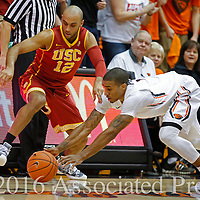 Oregon State's Gary Payton II, right, steals the ball from USC's Julian Jacobs in the first half of an NCAA college basketball game in Corvallis, Ore., on Sunday, Jan. 24, 2016.  (AP Photo/Timothy J. Gonzalez)