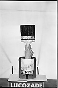 16/05/1963<br /> 05/16/1963<br /> 16 May 1963<br /> Product shot of a can of Calcimat paint for interior and exterior use, mounted on a Lucozade box with hand and brush and shot for Lynches Advertising.