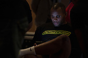 "Daniel ""DC"" Cormier sits back stage before the official UFC 187 weigh-in event at the MGM Grand in Las Vegas, Nevada on May 22, 2015. (Cooper Neill)"